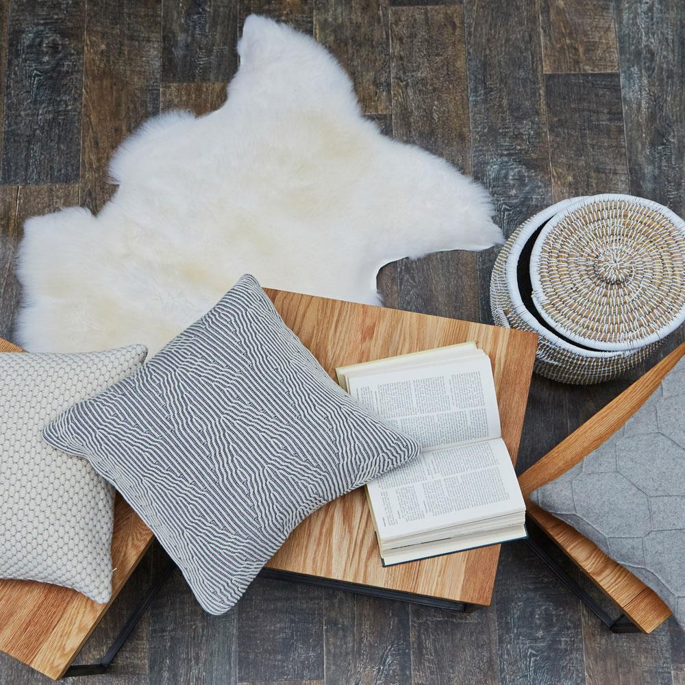 A natural sheepskin rug adds warmth and character to your interior.