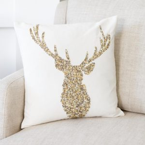 Sequinned Stag Cushion- Beautifully embellished in gold, bronze and warm silver beading, this pure cotton ivory cushion is updated for the festive season. €39.95